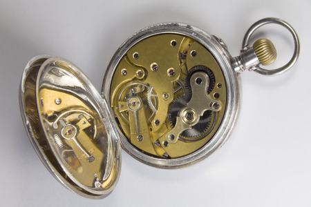 horologe: Antique watches made of silver metal. The cover of watches mechanism is opened.