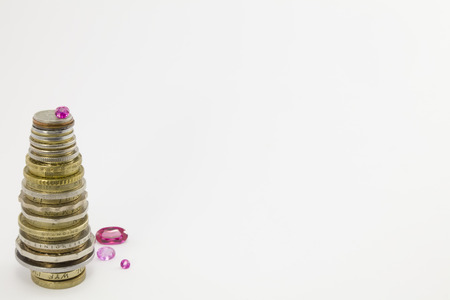 vermeil: Column of coins with rubies in the form of a Christmas tree on a white background. Clarity in the middle column. Stock Photo
