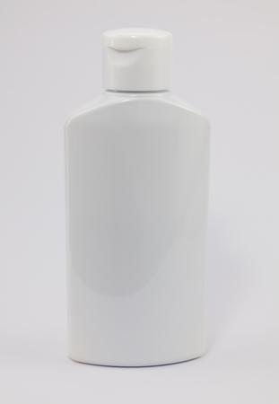 dispensary: White plastic jar on a white background. Medical plastic jar of shampoo.