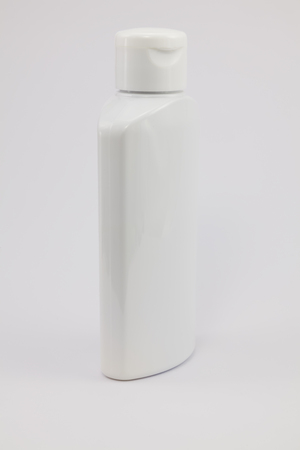 therapeutical: White plastic jar on a white background. Medical plastic jar of shampoo.