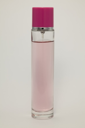 unguent: Pink perfume bottle on a white background. Cosmetic glass jar of perfume. Stock Photo