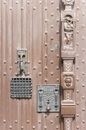pitting: Vintage antique wrought door. Antique locks and carvings. Stock Photo