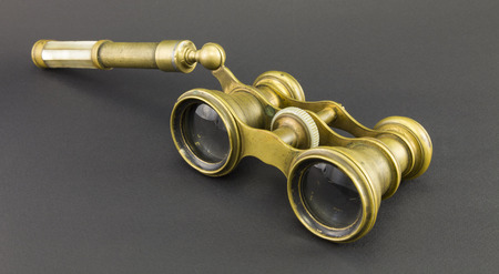 antique binoculars: Natural vintage opera glasses with pearl inserts on a dark background.