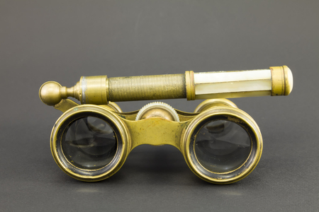 inserts: Natural vintage opera glasses with pearl inserts on a dark background.