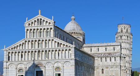 The Cathedral of Pisa Duomo di Pisa with the Leaning Tower of Pisa Torre di Pisa in Piazza dei Miracoli.