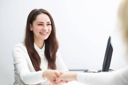 concludes: beautiful smiling business woman in the office concludes contract