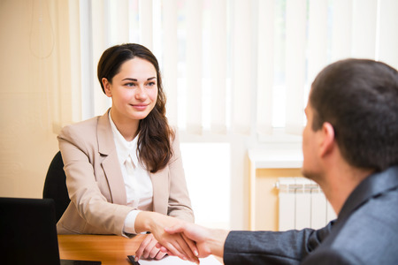 A smiling business woman shakes her hand at the interview Stock Photo