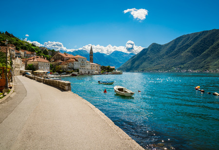 sunny sky: Harbour and boats at Boka Kotor bay (Boka Kotorska), Montenegro, Europe. Stock Photo