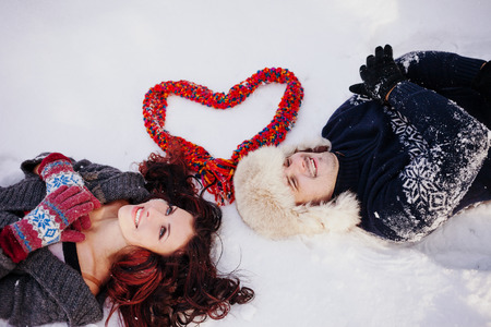 love kiss: Outdoor fashion portrait of young sensual couple in cold winter weather. Love and kiss.