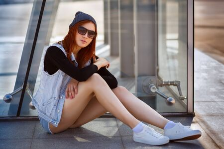 tomboy: Outdoor fashion lifestyle portrait of pretty young girl, wearing in hipster swag grunge style urban background. Tomboy city concept