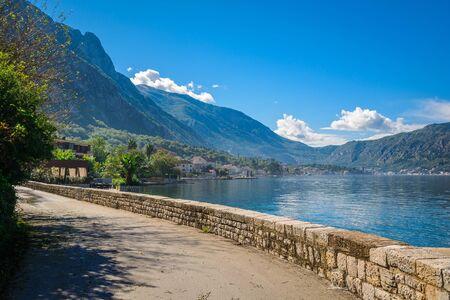 boka: Harbor and ancient buildings in sunny day at Boka Kotor bay (Boka Kotorska), Montenegro, Europe.