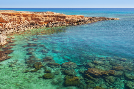 rock arch: Beautiful natural rock arch near of Ayia Napa, Cavo Greco and Protaras on Cyprus island, Mediterranean Sea. View near of Legendary bridge lovers. Amazing blue green sea and sunny day.