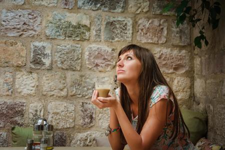 Beautiful girl drinking coffee.