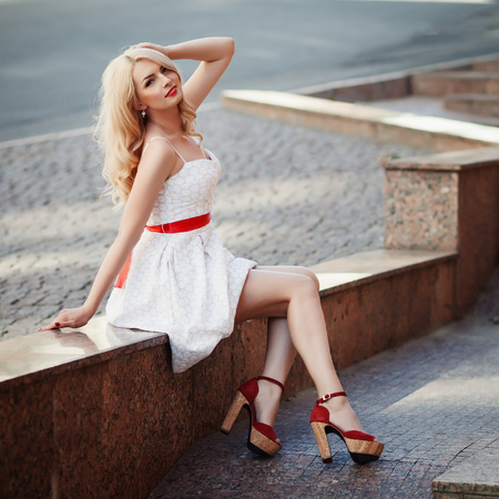Fashion outdoor portrait of beautiful elegant blonde woman wearing pin up style