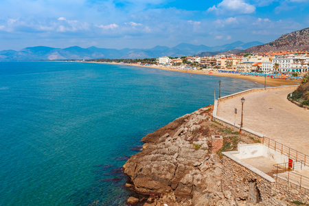 Sea landscape with Sperlonga, Lazio, Italy. Scenic resort town village with nice sand beach and clear blue water in picturesque bay. Famous tourist destination in Riviera de Ulisse