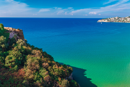 Panoramic sea landscape with Gaeta, Lazio, Italy. Scenic historical town with old buildings, ancient churches, nice sand beach and clear blue water. Famous tourist destination in Riviera de Ulisse