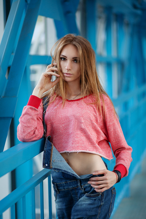 Outdoor lifestyle portrait of pretty young girl, wearing in hipster swag grunge style urban background.