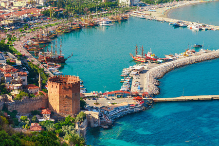 Landscape with marina and Kizil Kule tower in Alanya peninsula, Antalya district, Turkey, Asia. Famous tourist destination with high mountains. Part of ancient old Castle. Summer bright day Stock fotó