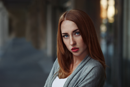 Beautiful redhair young woman in casual closes in urban background. Fashion Photo Stock fotó