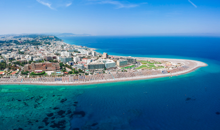Aerial birds eye view drone photo of Elli beach on Rhodes city island, Dodecanese, Greece. Panorama with nice sand, lagoon and clear blue water. Famous tourist destination in South Europe