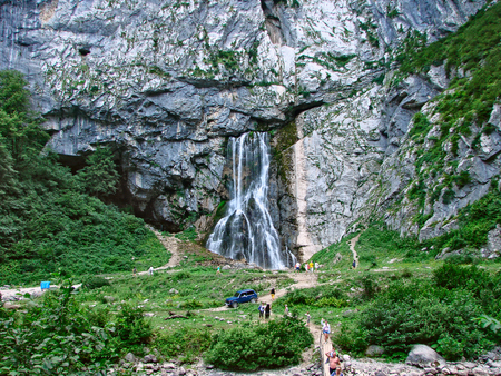 unrecognisable person: Gegsky waterfall in Abkhazia. General view. Horizontal shot. Unrecognizable people. Editorial