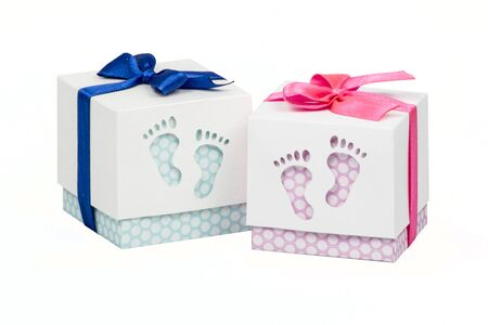 dekor: Two small boxes with gift for a newborn baby, pink and blue polka dots, top decorated with bow