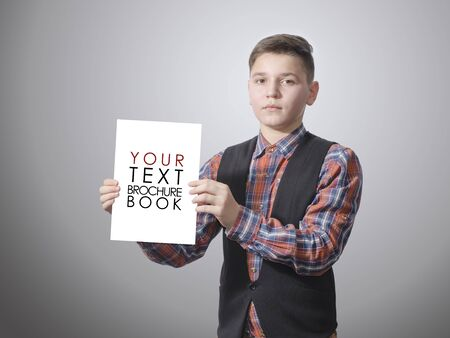 Teenager holding a blank white template for advertising. On a white background. photo