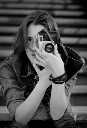 Young girl with old camera photo