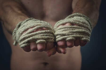 Hands Thai boxer in the foreground, the traditional hemp rope wrapped to match or training photo
