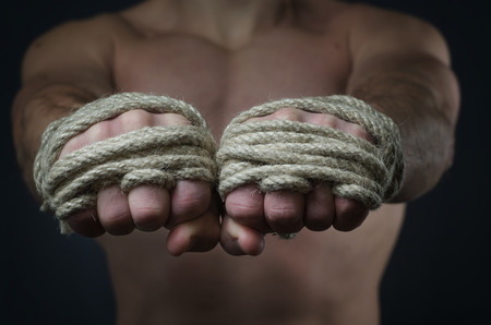 combative sport: Hands Thai boxer in the foreground, the traditional hemp rope wrapped to match or training