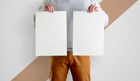 Two Template mocup posters in the hands of men. White forms of a flyer in hand, isolated against a background with a diagonal strip.