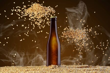 Drink template series. Brown beer bottle with reflections on a  smoke umber  background with two heaps of scattering wheat. Mockup ready to use on your showcase.
