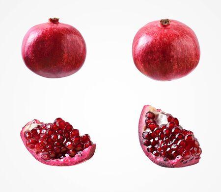 Subtropische Fruchtkomposition. Gesundes buntes rotes Granatapfelisolat auf leerem Studiohintergrund.