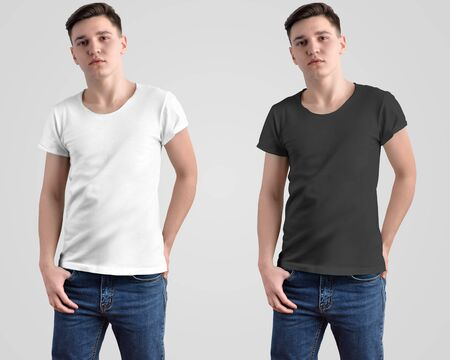 Design mockup of a white and black t-shirt on a young guy. Front view in the studio. Template for presentation in the store and advertising clothing.