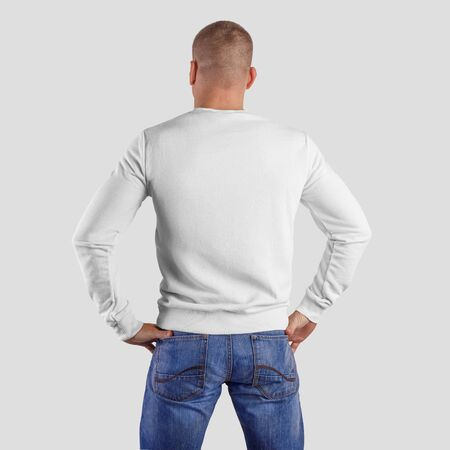 Mockup blank pullover on a man in blue jeans, back view, for presentation of design and print.