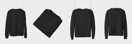Mockup of black textile sweatshirt hanging on a hanger and rope, isolated on a white background. Blank incline and folded heathers template for presentation design. Set of fashion pullovers Фото со стока