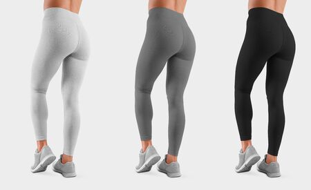 Template sweatpants on a fit girl with bent leg, isolated on background, back view. Mockup of white, gray, black leggings on a model for design presentation. Set of women's clothing