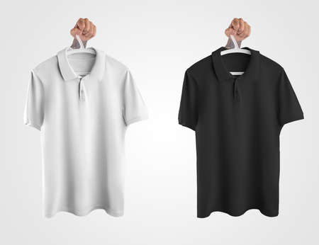 Mockup of white, black polo hanging on a hanger in hand, clothes for men, isolated on background. Template for a branded t-shirt with a collar, for design presentation, print. Set of clothes, front view