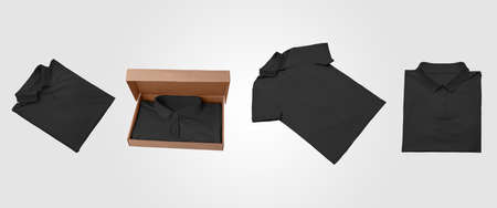 Mockup of black beautifully folded polo, presentation of mens t-shirt in an open box, isolated on background. Fashionable clothes template for your design, advertising. Stylish apparel set, front view