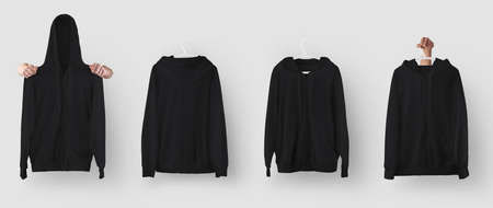A set of mockups of a black hoodie with a zipper, pocket, hanging on a hanger, holding in your hands, a sweatshirt with folds.Clothes template isolated on background, for design presentation, front, back
