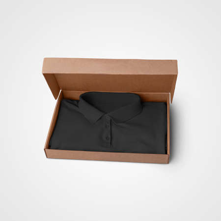 Presentation mockup of black textured polo, folded in a box, for design. Men's clothing template with buttons, collar, t-shirt isolated on background, front view, for advertising in an online store Banque d'images