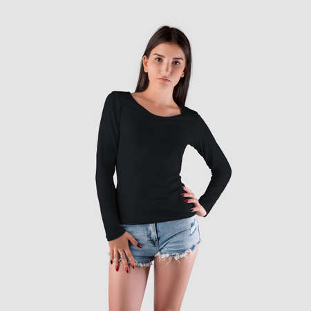 Template of women's clothing with long sleeves on a young girl, front view, branded with clothes for presentation of design. Mockup of stylish black pullover for women isolated on background.