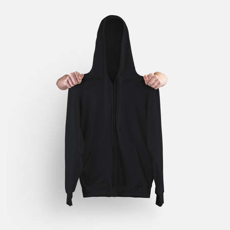 Mockup blank textured long sleeve sweatshirt, with zipper closure, drawstring hoodie, isolated and holding shoulders with hands, front view. Black clothes template for presentation design