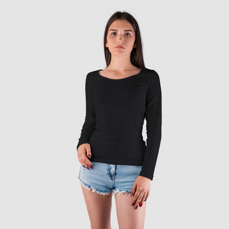 Mockup of a black women's sweatshirt with long sleeves for a girl of Caucasian appearance in short shorts, clothes for design presentation. Casual textile pullover template isolated on background Banque d'images