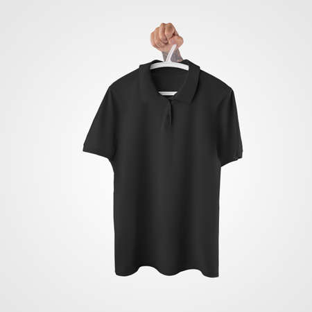 Mockup of a black blank polo, on a hanger in hand, stylish clothes with buttons, collar, isolated on background. Fashion t-shirt template for design presentation, online store advertising, front view