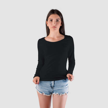 Long sleeve womens clothing mockup on caucasian girl in shorts, black sweatshirt isolated on background.Casual fashion pullover template for design presentation.Fashionable textured clothing for women