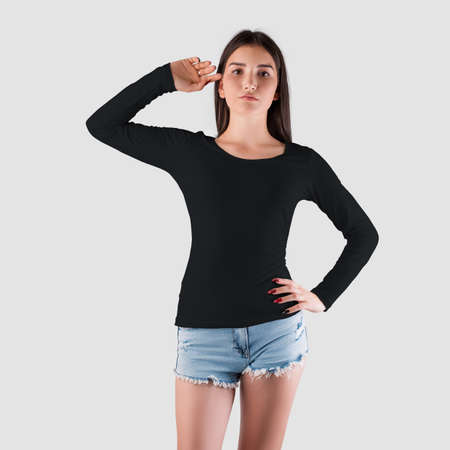Mockup of a black sweatshirt with long sleeves for a girl of Caucasian appearance, in shorts, a pullover for the presentation of the design. Womens casual clothing template isolated on background, front