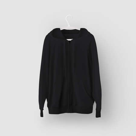 Mockup of black hoodie with pocket, zipper, hanging on a plastic hanger, front view, isolated on background. Stylish long-sleeved clothing template for design presentation, print, pattern Banque d'images