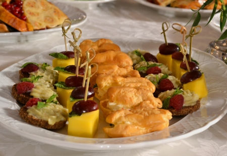 Banquet table. Canape (cheese, bacon, grapes,bread ) Stock Photo - 10172136