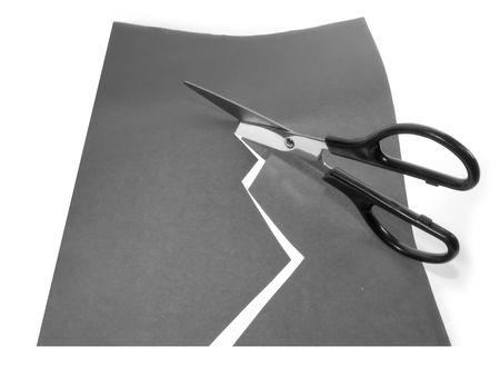 Scissors cutting a paper photo